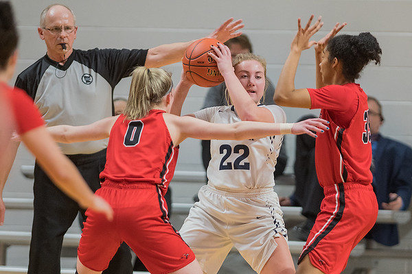 Minnehaha Academy's Taytum Rhoades and Lydia Schroeder try to trap St. Peter's Jacey Welp as the Red Hawks employed a full court press against the Saints in the first half. Photo by Jackson Forderer