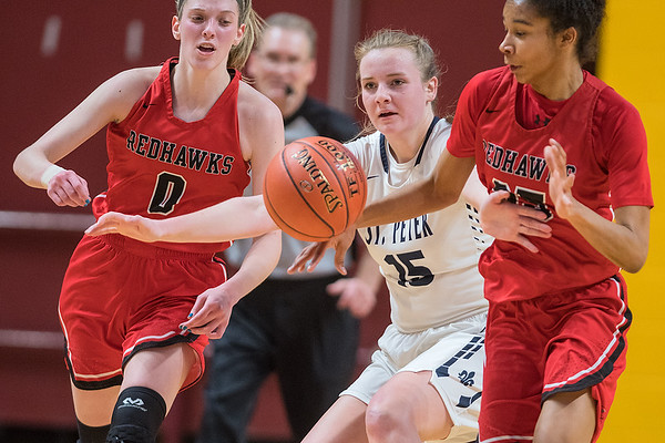 St. Peter's Sarah Conlon tries to sheild Minnehaha Academy players Taytum Rhoades and Lydia Schroeder away from the ball after Rhoades tipped the ball away from Conlon. Photo by Jackson Forderer
