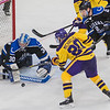 Minnesota State's Marc Michaelis goes after a rebound in the crease against University of Alabama-Huntsville's goalie Mark Sinclair and Cam Knight in the second period of Friday's WCHA tournament game. Photo by Jackson Forderer