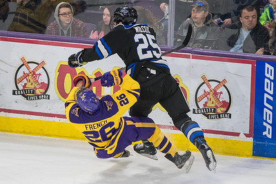 Josh French of Minnesota State takes a ht from Adam Wilcox of University of Alabama-Huntsville in a very physical WCHA playoff game. MSU won the game 3-1 to open the WCHA tournament. Photo by Jackson Forderer