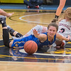 Waseca's Gus Boyer (center) watches a loose ball roll past her as she and Marshall's Kaia Sueker (right) fought for possession on the ball at half court. The Bluejays were upset by the Tigers 53-44 in the Section 2AAA championship game. Photo by Jackson Forderer