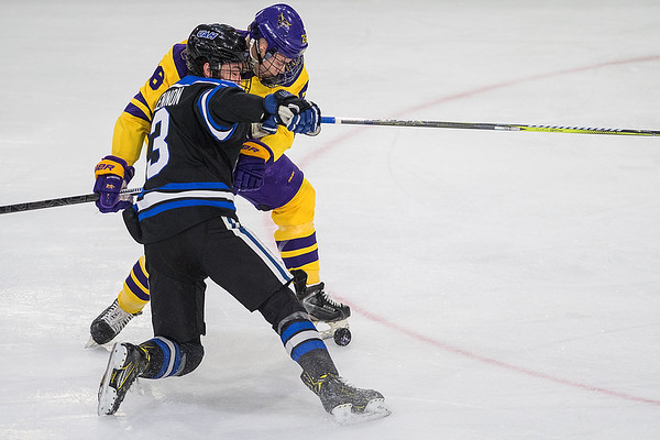 Minnesota State's Josh French checks Drew Lennon of University of Alabama-Huntsville as the Mavericks opened the WCHA tournament with a 3-1 win over the Chargers. Minnesota State's Photo by Jackson Forderer