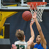 Waseca's Kyreese Willingham blocks a shot put up by Faribault's Maverick Jeanes in the first half of Friday's Section 2AAA playoff game played at Gustavus. Photo by Jackson Forderer