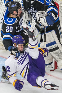 Minnesota State's Max Coatta is taken down by University of Alabama-Huntsville's Bailey Newton in front of the goal crease. Newton was called for a penalty on the play. The Mavericks won the game 4-1 to advance in the WCHA tournament. Photo by Jackson Forderer