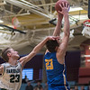 Faribault's Maverick Jeanes fails to stop Waseca's Andrew Morgan from dunking the ball in the first half of Friday's Section 2AAA playoff game. Photo by Jackson Forderer