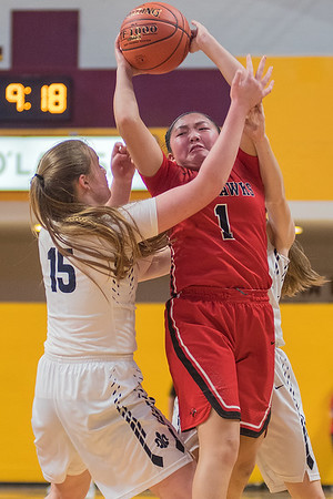 Sarah Conlon (15) and teammate Madison More (hidden) trap Minnehaha Academy's Tanna Gallo in the second half of play. Photo by Jackson Forderer