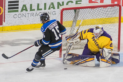 Minnesota State goalie Dryden McKay makes a save against University of Alabama-Huntsville forward Hans Gorowsky on a breakaway in the third period. Photo by Jackson Forderer