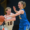 Waseca's Brianna Highum (right) tries to steal the ball away from Marshall's Erica Jones in the second half of Thursday's Section 2AAA championship game. Photo by Jackson Forderer