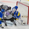 Minnesota State's C.J. Seuss (15) flips the puck up and over the pad of University of Alaska Fairbanks' goalie Niko Dellamaggiore in the third period for one of the Maverick's eight goals on the evening. The Mavericks won 8-2 in the first game of the WCHA playoffs. Photo by Jackson Forderer