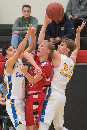 St. Clair's Mason Ward (center) loses control of the ball while being trapped by Mankato Loyola's Micah Rentschler (left) and Hunter Westman (22) in the second half of Tuesday's Section 2A playoff game. Ward's turnover was nullified by a called timeout moments prior by head coach Charles Freitag. Loyola's trapping defense caused problems for the Cyclones who escaped with 55-54 win. Photo by Jackson Forderer