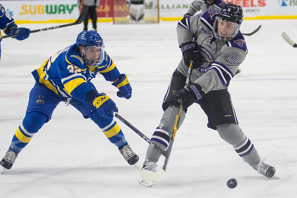 Minnesota State's Parker Tuomie (right) takes a shot on goal while being chased by University of Alaska Fairbanks' Tristan Thompson in the first period of Friday's game played at the Verizon Center. Photo by Jackson Forderer