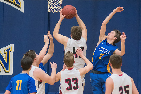 Mankato Loyola's Zan Raverty (right) tries to block a shot put up by Alden-Conger's Gavin Steele in the second half of Thursday's game played at the Fitzgerald gym. Loyola won the game 73-34 to advance in the Section 2A tournament. Photo by Jackson Forderer