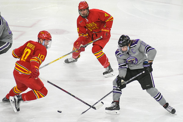 Minnesota State's Brad McClure (right) takes a shot on goal past Ferris State's Coale Norris (left) in a game played at the Verizon Center on Feb. 16. Photo by Jackson Forderer
