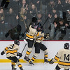 Sam Schulz (center) of Mankato East is swarmed by his teammates in front of the East student section after scoring a goal against Rochester Lourdes in the second period. Photo by Jackson Forderer