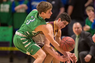 Maple River's Mason Sohre (left) goes for a steal against Noah Schmitt of Jordan in the first half of Friday's Section 2AA championship game. Jordan downed the Eagles and won 64-56. Photo by Jackson Forderer