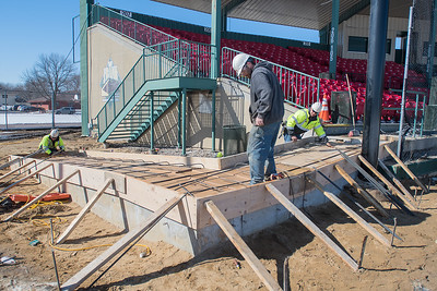 From left, Josh Wieland, Tom Juberien and Brian Esser from Web Construction install rebar into the handicap access ramp as part of the renovations being done at Franklin Rogers Park. The construction will be finished in time for the start of the MoonDogs season, but will displace both the Mankato West and Loyola baseball teams this spring. Photo by Jackson Forderer