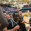 Mankato East boys basketball teammates surround Uhana Ochan (center) after they defeated Waseca 78-70 in a nail-biting Section 2AAA championship game played on Thursday in St. Peter. Photo by Jackson Forderer