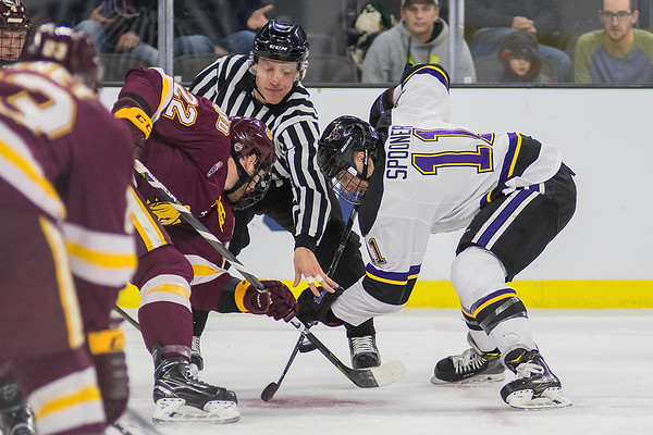 Minnesota State's Jared Spooner (right) takes a face-off against University of Minnesota Duluth's Matt Anderson in the first period. Photo by Jackson Forderer