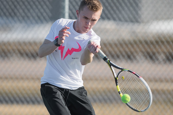 Mankato East's Tyler Homich hits a forehand while playing a singles match during practice on Tuesday. Photo by Jackson Forderer