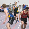 Luke Montgomery of Mankato Loyola/Cleveland runs towards his relay teammate Isaiah Ewert in the first leg of the sprint medley relay during Tuesday's track meet held at Bud Myers Field House. The relay team set the stage for Micah Rentschler to win the event for Loyola/Cleveland. Photo by Jackson Forderer