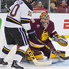 University of Minnesota Duluth goalie Hunter Shepard keeps his eyes on the puck while Minnesota State's Zeb Knutson tries to play the puck out of mid air in the first period. MSU jumped out to a 2-0 lead but lost in overtime 3-2. Photo by Jackson Forderer