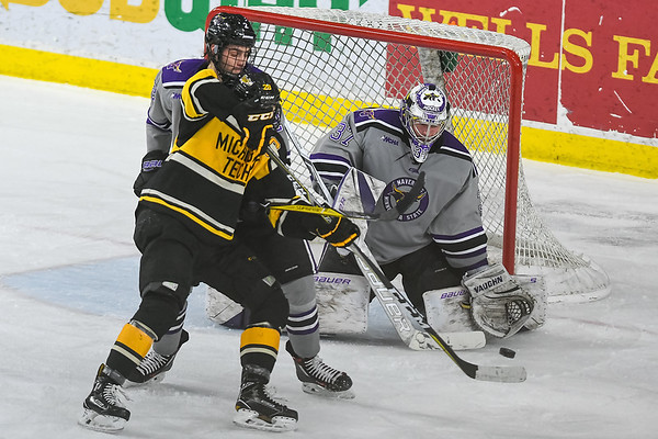 Minnesota State goalie Connor LaCouvee prepares to make a glove save as Michigan Tech's Brent Baltus tries to tip the puck in a WCHA semifinal playoff game at the Verizon Center. Photo by Jackson Forderer