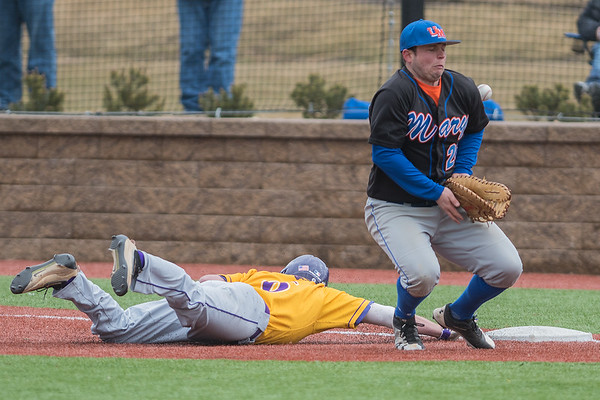 Minnesota State's Josh Wenzel slides safely back to first base after University of Mary's Will Pettener mishandles a throw in a pick off attempt in the second game of a double header played on Friday. Photo by Jackson Forderer