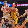 Mankato East's Damani Hayes (center) tries driving the lane against Delano's Max Otto (left) and Calvin Wishart during Wednesday's game played at Williams Arena. Photo by Jackson Forderer