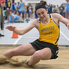 Jenny Vetter of Mankato East lands in the pit during a long jump attempt during Thursday's track and field meet held in the Myers Field House. Photo by Jackson Forderer