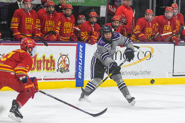 Minnesota State forward and Sioux Falls, S.D. native Zeb Knutson (right) flips the puck to a teammate in a game played against Ferris State on Feb. 16. Photo by Jackson Forderer