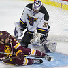 University of Minnesota Duluth's Karson Kuhlman (20) slides through the crease after scoring a break away goal past Minnesota State goalie Connor LaCouvee in the second period. MSU jumped out to a 2-0 lead, but UMD capped a comeback with a 3-2 overtime victory. Photo by Jackson Forderer