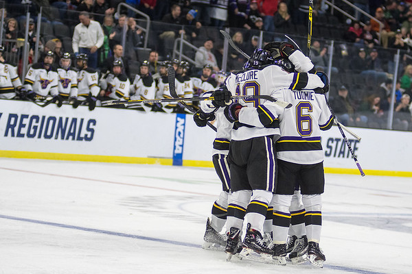 Minnesota State players celebrate after Ian Scheid scored a power play goal for the Mavericks against University of Minnesota Duluth in the first period. The Mavericks jumped out to a 2-0 lead, but UMD came back to win 3-2 in overtime. Photo by Jackson Forderer