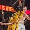 Mankato East's Uhana Ochan has his shot blocked by Delano's Keegan O'Neill during the opening round of the boys basketball state tournament played at Williams Arena. Ochan led the Cougars with 18 points and eight rebounds. Photo by Jackson Forderer