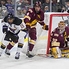 Minnesota State's C.J. Seuss (left) tries a wrap around attempt but is stopped by University of Minnesota Duluth's Dylan Samberg. Photo by Jackson Forderer