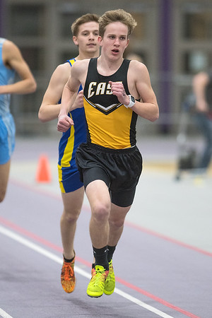 Mankato East's Jett Oachs runs in the one-mile race during Thursday's track and field meet held indoors at the Myers Field House. Photo by Jackson Forderer