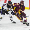 Minnesota State's Max Coatta (left) tries to stop University of Minnesota Duluth's Scott Perunovich from getting the puck in the second period. UMD won 3-2 in overtime. Photo by Jackson Forderer