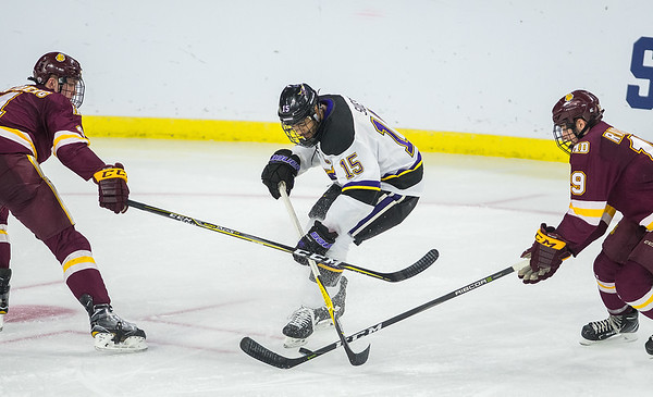 Minnesota State's C.J. Suess is defended by University of Minnesota Duluth's Dylan Samberg (left) and Justin Richards (right) during the second period of Friday's game played in Sioux Falls. Photo by Jackson Forderer