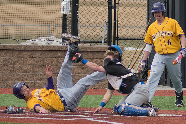 University of Mary catcher Cody Ghents successfully tags out Cam Kline of Minnesota State at home plate. The Mavericks took both games of a double header played on Friday. Photo by Jackson Forderer