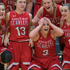 Emily Veroeven (3) is overcome with emotion as she and her Mankato West teammates line up for a team picture after beating Waseca 47-37 in the Section 2AAA championship game played at Gustavus on Thursday.  Photo by Jackson Forderer