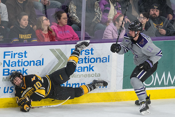 Minnesota State's Jared Spooner (right) checks Michigan Tech's Jake Jackson into the boards during Friday's WCHA semifinal playoff game played at the Verizon Center. Spooner scored the Mavericks first goal, which was key in the 2-1 victory over the Huskies. Photo by Jackson Forderer