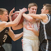 Mankato West's Dalton Hirsch (center) gets tangled up with Mankato East's Ryan Kuechle (left) and Jax Madson (right) during Saturday's Section 3AAA semifinal game. Madson led East in scoring to help the Cougars to the section championship game. Photo by Jackson Forderer