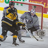 Minnesota State's Connor LaCouvee watches a shot on the way to the net as Michigan Tech's Brent Baltus tries to tip the puck. LaCouvee and the Maverick defense held Michigan Tech to one goal in Friday's game. Photo by Jackson Forderer