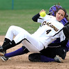 Pat Christman<br /> Gustavus Adolphus College's Christina Riester is knocked over by St. Thomas' Genny Duffy during the fourth inning of their MIAC tournament game Saturday at Caswell Park.