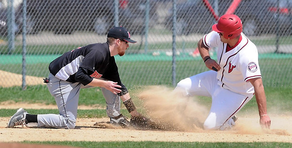 John Cross<br /> Martin Luther third baseman Joe Janke puts the tag on Bethany Luthern's Clint Aretz during an unsuccessful steal attempt in the second inning of the first game of a Monday doubleheader.