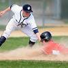 Rochester Century's Matthew Sturchio tags out Mankato West's Kevin Marzolf at third base during their first game Tuesday at Franklin Rogers Park.