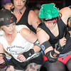 M.A.D. Derby Girls' Strawberry StrikeHer, right, collides with the Moose Lake Mafia's Cutie Boom during their roller derby match Saturday at the Verizon Wireless Center.