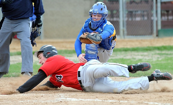 Pat Christman<br /> St. Clair's Philiip Lonneman slides into home under the tag of Mankato Loyola catcher Blake Matuska during the second inning Thursday at Franklin Rogers Park.