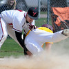 Bethany third baseman Dylan Gass puts the tag on Minnesota-Morris base runner Ryan Wynn during the first game of a triple header on Monday. Photo by John Cross