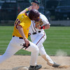 Minnesota-Morris baserunner Eric Terres is out at 2nd as Bethany shortstop Mitch Sellers turns a double play in sixth inning action of the first of three games played on Monday. Photo by John Cross