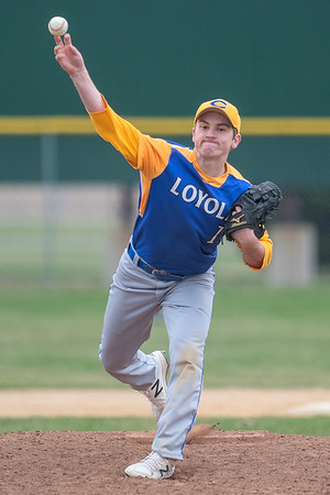 Mankato Loyola's Ben Ellingworth delivers a pitch to a  Lake Crystal Wellcome Memorial batter in the first game of a double header played on Tuesday in Lake Crystal. Ellingworth blanked the Knights offense, helping the Crusaders win 11-0. Photo by Jackson Forderer